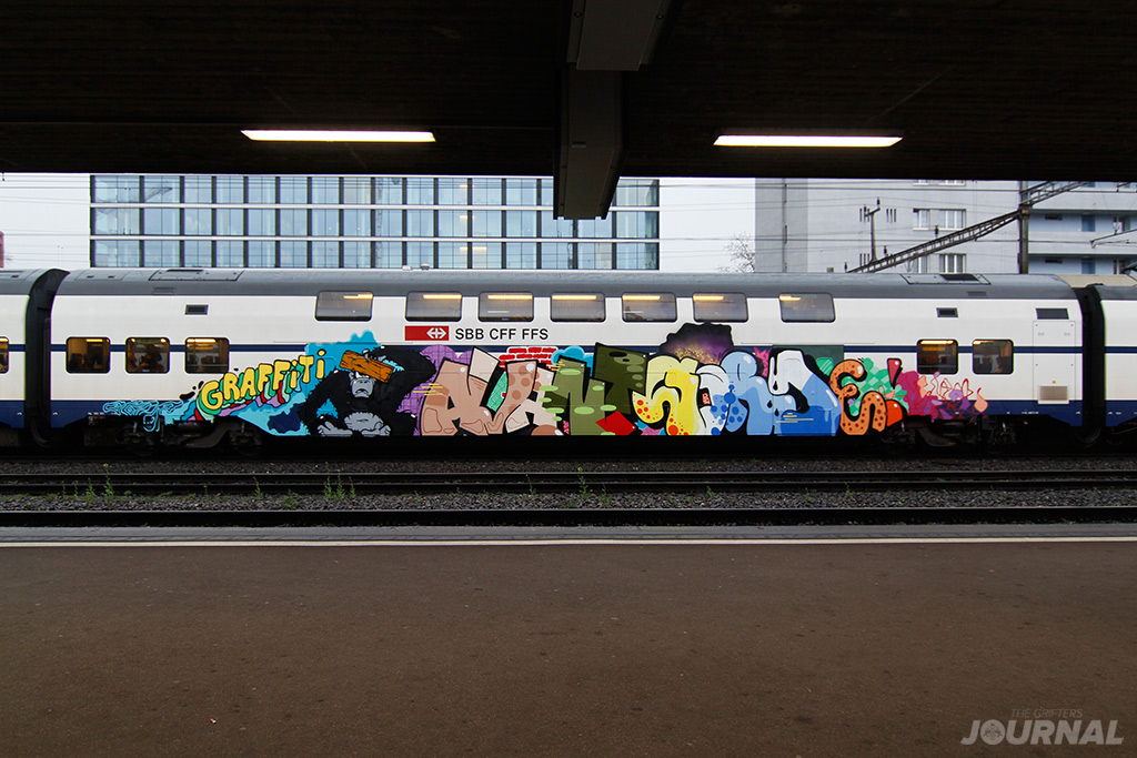 graffiti-avnat-garde-moses-taps-topsprayer-switzerland-comuter-train-the-grifters-journal