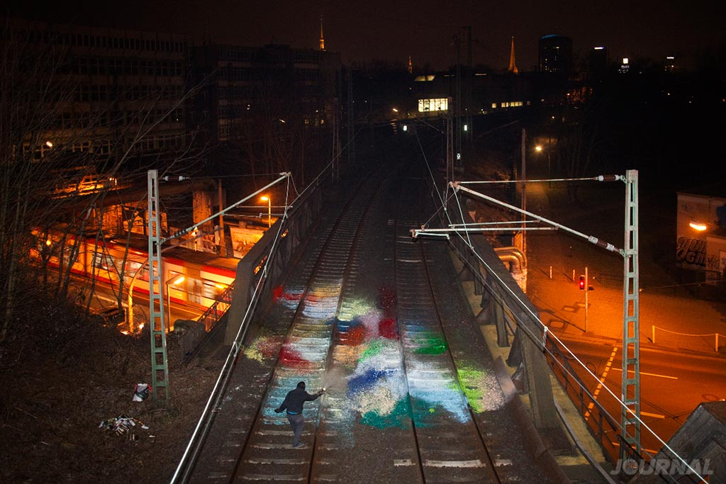 paint-splash-on-railway-tracks-moses-taps-topsprayer-the-grifters-journal